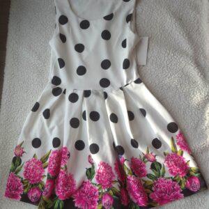 Robe motif gros pois puis motif fleurs fushia (enfant du 2 ans aux 14 ans)